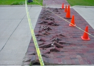 Record high temperatures cause this pavement to buckle as the concrete expanded