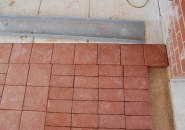 Clay pavers shrink during the firing process causing variation in size