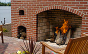 Patio and Fireplace Constructed Using Whitacre Greer Fired-Clay Paving Brick And Fire Brick