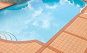 Fired-Clay Paving Brick Surround This Syracuse, New York Pool