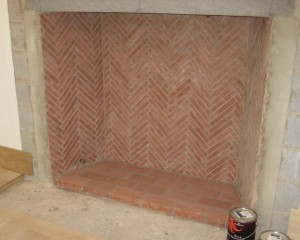HeatStop Refractory Mortar was used to construct this herringbone-pattern fireplace. Whitacre Greer Red Firebrick Splits are featured.